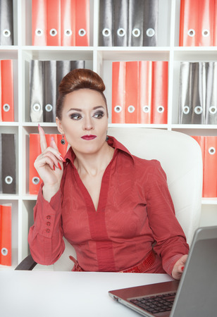 afflatus: Beautiful business woman having idea working at office Stock Photo