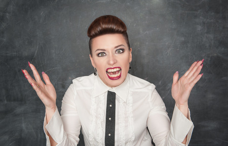 Angry screaming woman on the blackboard background Stock Photo - 25903687