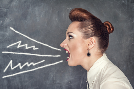 Screaming fashion woman on the blackboard background Stock Photo - 25903688
