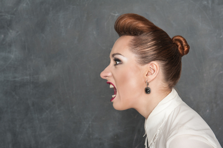 Angry screaming woman on the blackboard background Stock Photo - 25931594