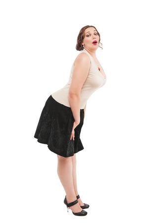 Beautiful plus size woman posing on white background