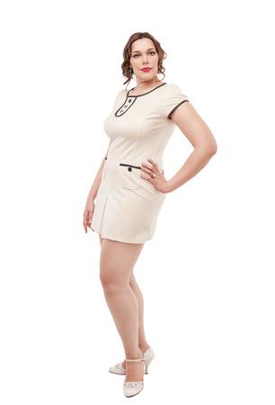 Beautiful plus size woman posing on white background photo