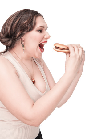 Beautiful plus size woman eating hamburger isolated photo