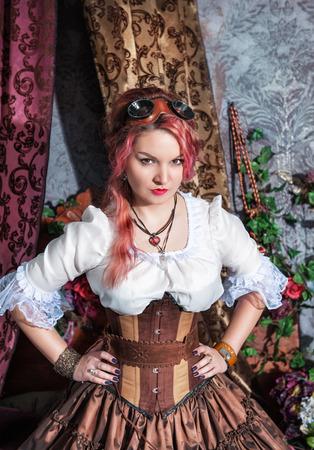 steampunk goggles: Mujer steampunk hermosa con el pelo de color rosa