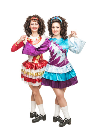 Two irish dancers in hard shoes and wig posing isolated photo