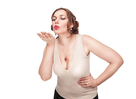 Beautiful plus size woman sending kiss isolated photo