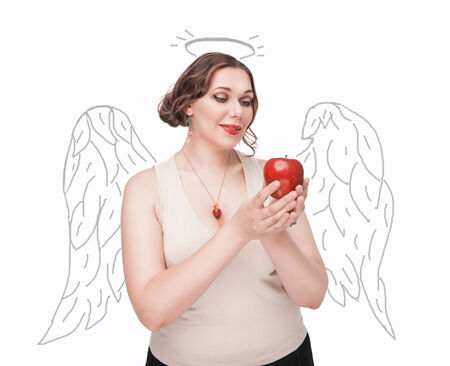 Beautiful plus size woman as angel with apple isolated photo