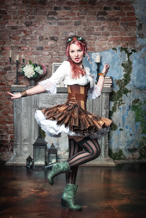Beautiful steampunk woman with pink hair spinning photo