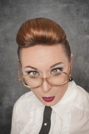 Crazy teacher with eyes crossed on the school blackboard background