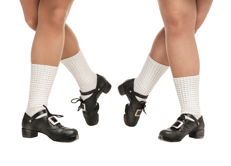 irish woman: Legs in hard shoes for irish dancing isolated