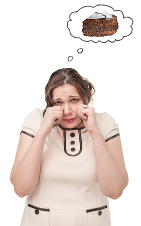 Plus size woman crying about cake on white background