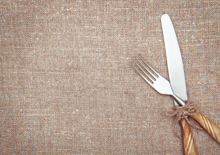 Fork and knife on the burlap textile  photo