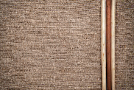 Burlap linen with three wooden sticks photo