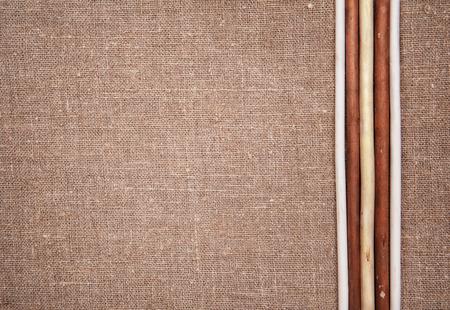 Burlap linen with five wooden sticks photo