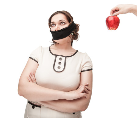 silenced: Beautiful brunette plus size woman refusing healthy food isolated