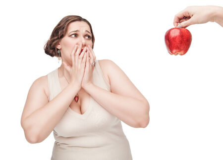 fearing: Plus size woman fearing healthy food on white background