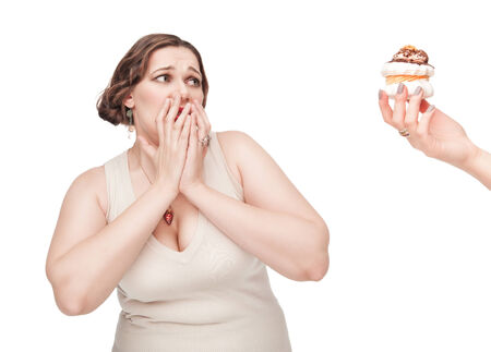 fearing: Plus size woman fearing unhealthy food on white background