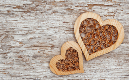Wooden decorative hearts on the old wooden background photo