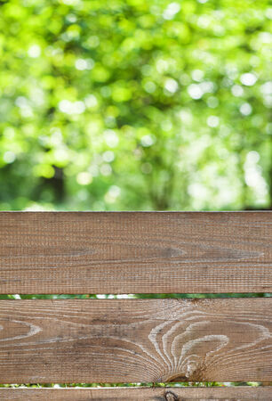 Empty weathered rustic old wooden board with abstract summer background photo