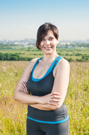 Fitness beautiful plus size woman smile outdoor photo