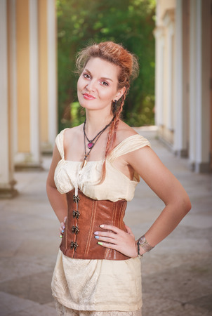 bodice: Beautiful young woman in corset and shorts outdoor Stock Photo