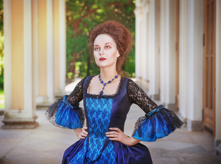 ruche: Beautiful young  woman in blue medieval dress outdoor