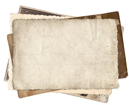 papel de notas: Manojo de fotos viejas con manchas y ara�azos fondo aislado Foto de archivo