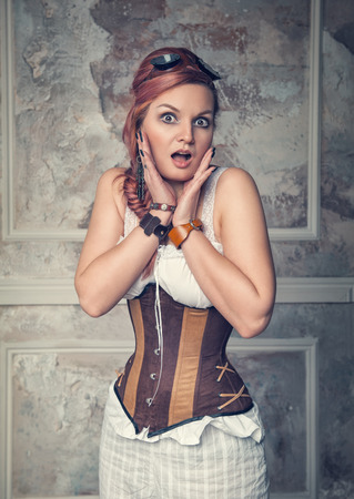 minx: Beautiful steampunk woman with pink hair surprised Stock Photo