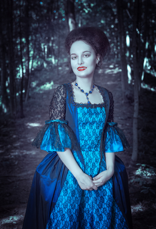 ruche: Beautiful woman vampire  in blue medieval dress outdoor Stock Photo