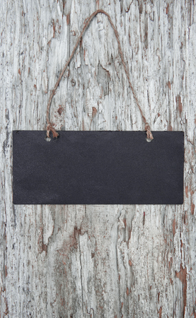 Chalkboard with rope on the old wood background photo