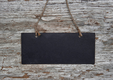 Chalkboard with rope on the old wood background