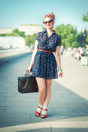 fifties: Beautiful young woman in fifties style with braces smiling outdoor