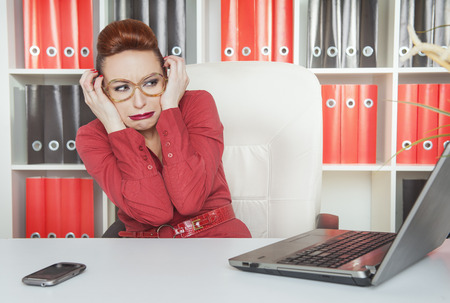Business woman scared working with computer in office photo