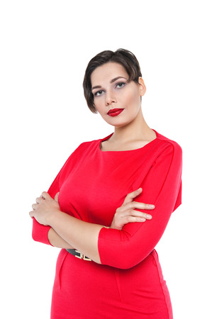 Beautiful plus size woman in red dress posing isolated on white background photo