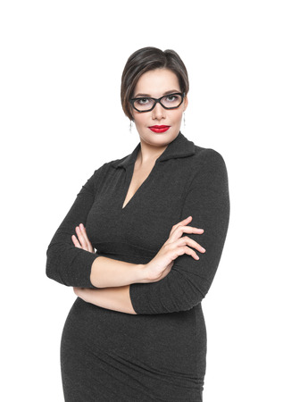 Beautiful plus size woman in black dress and glasses posing isolated on white background