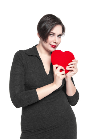 Beautiful plus size woman with red heart isolated on white background photo