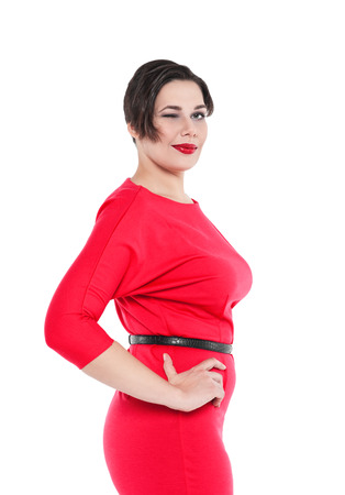 Beautiful plus size woman in red dress winking isolated on white background Zdjęcie Seryjne