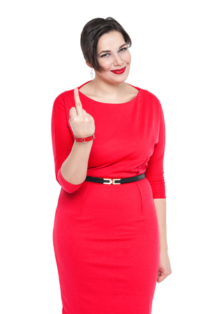 Beautiful plus size woman in red dress showing middle finger isolated on white background photo