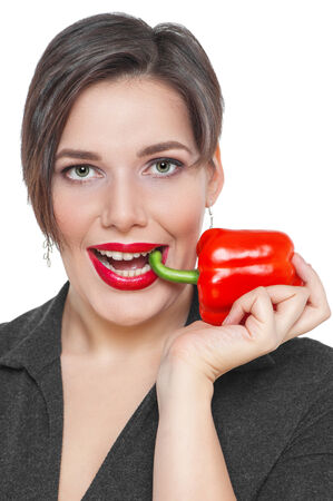 Beautiful plus size woman with red pepper isolated on white background