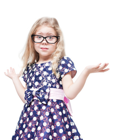 little girl dress: Beautiful little girl in glasses confused isolated over white background Stock Photo