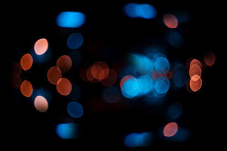 Blue and orange bokeh color abstract background with defocused lights photo