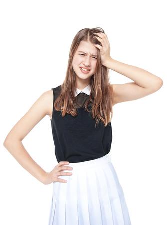 annoyed girl: Annoyed young fashion teenage girl isolated on white background