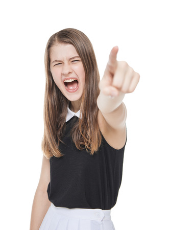 Angry teenage girl screaming and showing by finger isolated on white background Stock Photo - 37094913