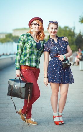 modern girl: Two beautiful hipster girls outdoor in the city Stock Photo