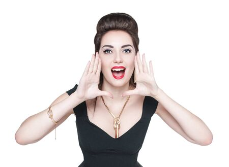 shaped hands: Young beautiful woman in retro pin up style shouting through megaphone shaped hands isolated