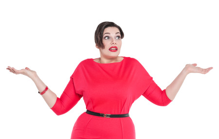 Beautiful plus size woman in red dress shrugs her shoulders isolated