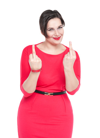 Beautiful plus size woman in red dress showing middle fingers isolated on white background photo