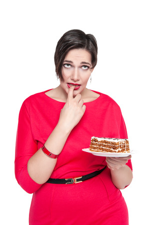 wish desire: Beautiful plus size woman temptating with cake isolated