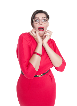 Scared plus size woman in glasses isolated on white background photo