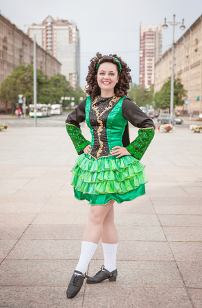 irish woman: Young woman in irish dance dress and wig posing outdoor